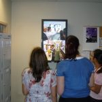 digital signage student area watching